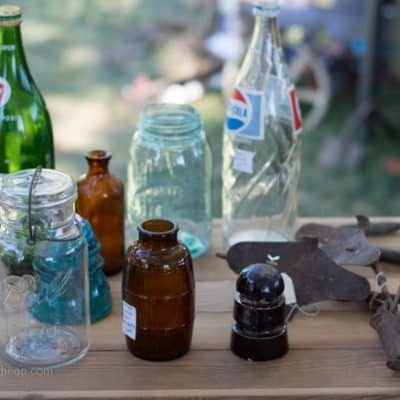 Vintage bottles collectibles at barn sale