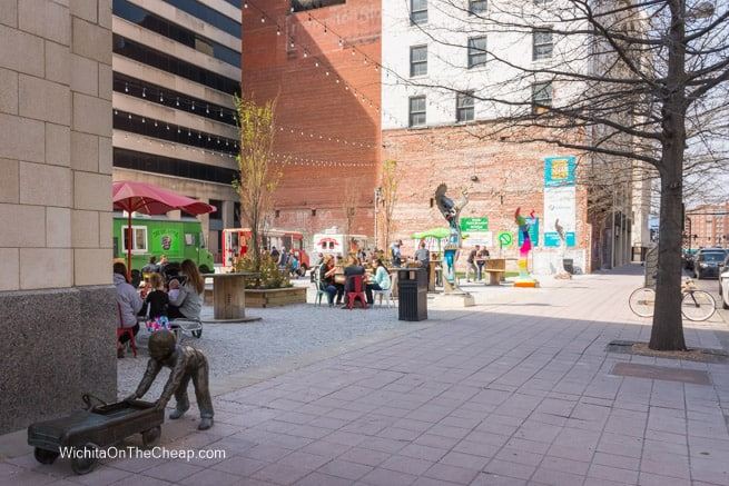 ICT Popup Urban Park with bronze sculpture in the foreground
