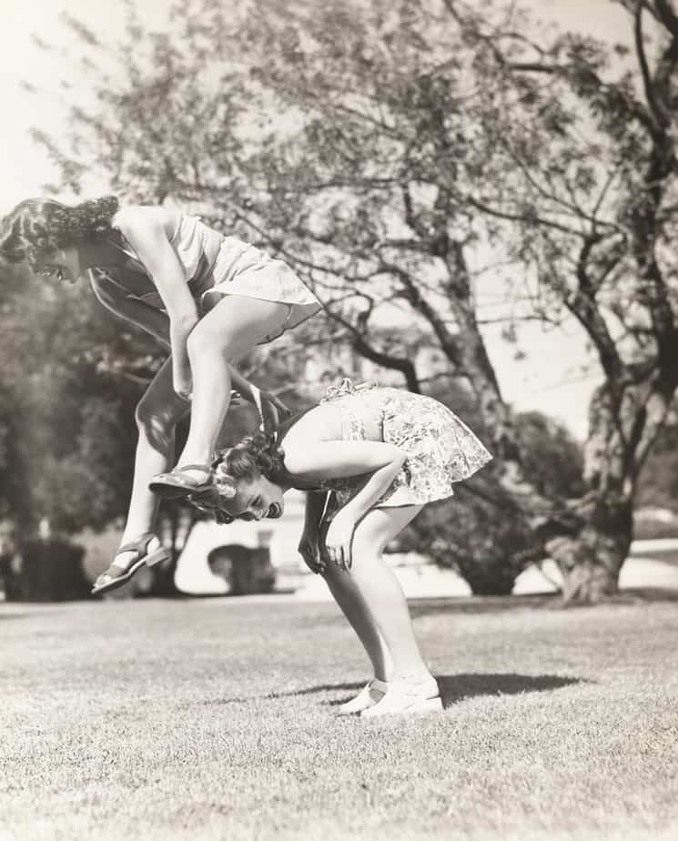 Playing leap frog vintage black and white photo