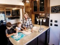 RV rental kitchen with mom and kids baking