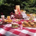 Picnic layout with Arby's 2 for $6 value meal included among the other food