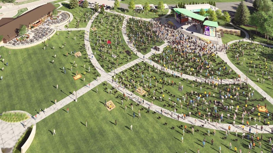 Aerial view of people sitting on the spacious lawn of the Capitol Federal Amphitheater in Andover, KS