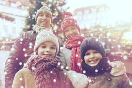 Christmas family outside in the snow