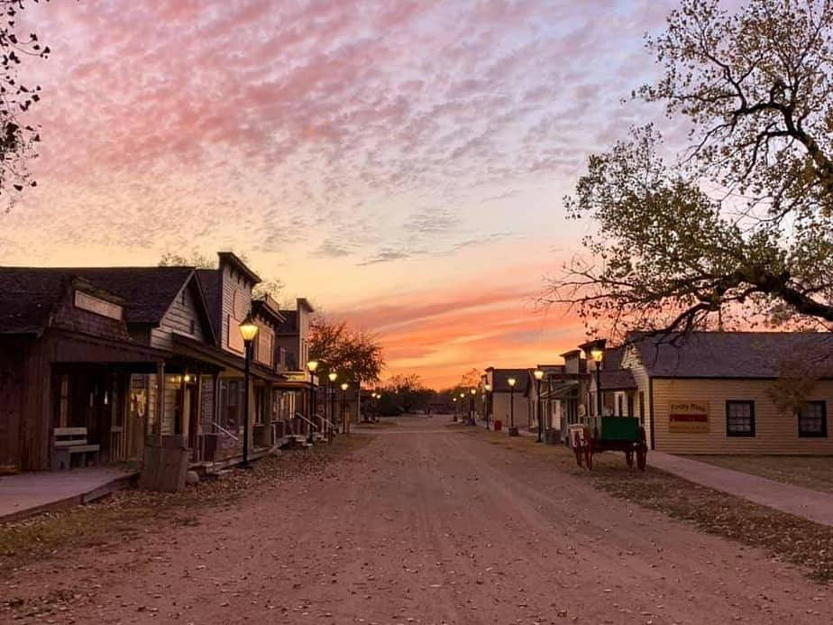 pink and gold sunset over Old Cowtown Museum street in Wichita KS