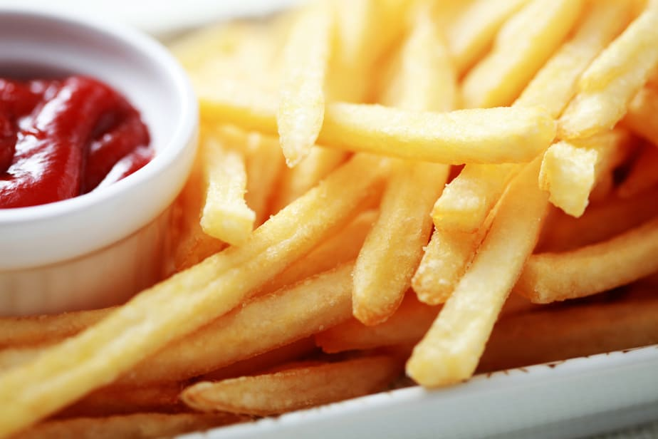 close-ups of french fries and ketchup