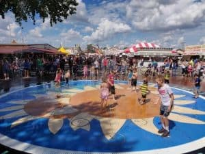 Kansas State Fair splash pad on fairgrounds kids playing, cooling off
