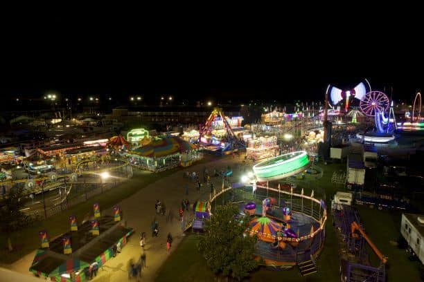 KS State Fair midway carnival at night - how to save on carnival ride tickets